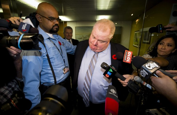 Then Toronto Mayor Rob Ford reacts to a video released of him by local media at City Hall in Toronto, in this November 7, 2013 file photo. REUTERS/Mark Blinch /Files TPX IMAGES OF THE DAY