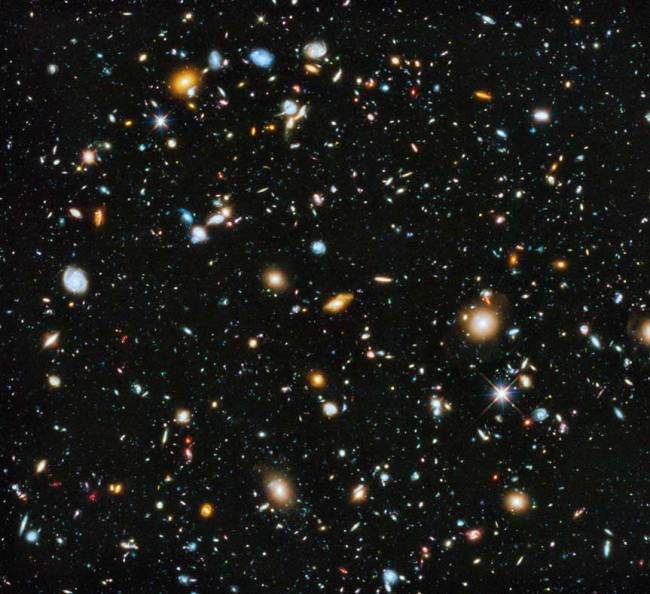 Composite image showing the visible and near infrared light spectrum This is a composite image showing the visible and near infrared light spectrum collected from Hubble's ACS and WFC3 instruments over a nine-year period. Astronomers using NASA's Hubble Space Telescope have assembled a comprehensive picture of the evolving universe – among the most colorful deep space images ever captured by the 24-year-old telescope. Researchers say the image, in new study called the Ultraviolet Coverage of the Hubble Ultra Deep Field, provides the missing link in star formation. The Hubble Ultra Deep Field 2014 image is a composite of separate exposures taken in 2003 to 2012 with Hubble's Advanced Camera for Surveys and Wide Field Camera 3.
