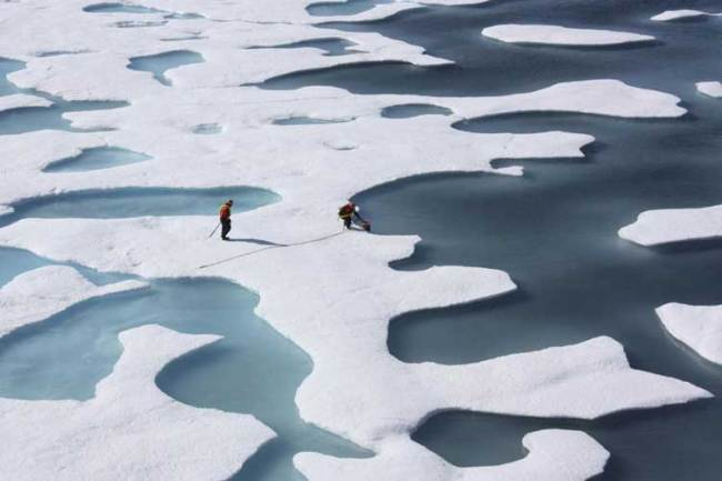 The crew of the US Coast Guard Cutter Healy, in the midst of their ICESCAPE mission, retrieves supplies in the Arctic Ocean Kathryn Hansen/NASA via REUTERS/File Photo