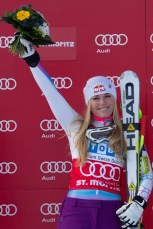 ST MORITZ, SWITZERLAND - DECEMBER 8: Lindsey Vonn of USA Winner on the podium during the flower ceremony at the Audi FIS Alpine Ski World Cup Super Giant Slalom (Super G) race on December 8 2012 in St Moritz, Switzerland. (Photo by Mitchell Gunn/ESPA) Image may be used for editorial purposes only.