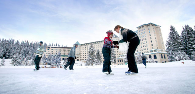 Ice-skating in front of the grand Fairmont Chateau Lake Louise.