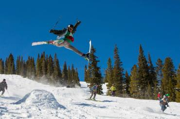 Daffys and spread eagles will earn you chairlift cheers.| Photo: Jeremy Swanson/Aspen Snowmass