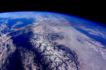 The Canadian Rockies blanketed in snow, as captured by camera from the International Space Station. | Photo: Scott Kelly, NASA