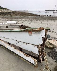 Alone Time  This retired skiff rests upon the shoreline posing as the harbor's m…