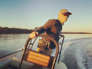 Whipping the tiller around the Wando searching for the next spot             …