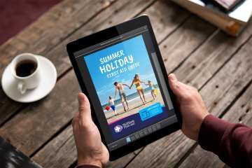 A man holding a tablet computer with the skillbase first aid brochure: Summer holiday first aid guide up on the screen.