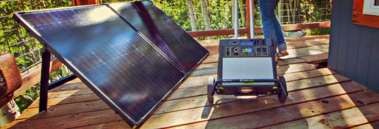 Solar Panel and Portable Solar Generator Setup On A Deck