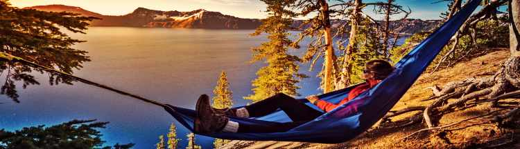 Hiker Relaxing in Hammock Crater Lake National Park Oregon