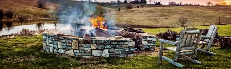 Bonfire in a firepit at sunset