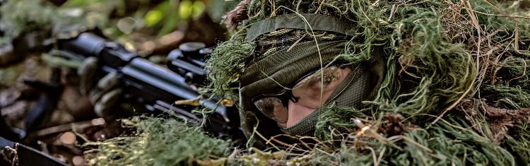 Hiding In Plain Sight In A Ghillie Suit