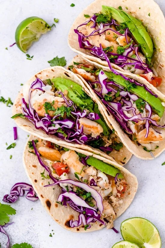 These easy Cilantro Lime Fish Tacos are made with flaky white fish, tomatoes, jalapeños, cilantro and lime topped with avocado.