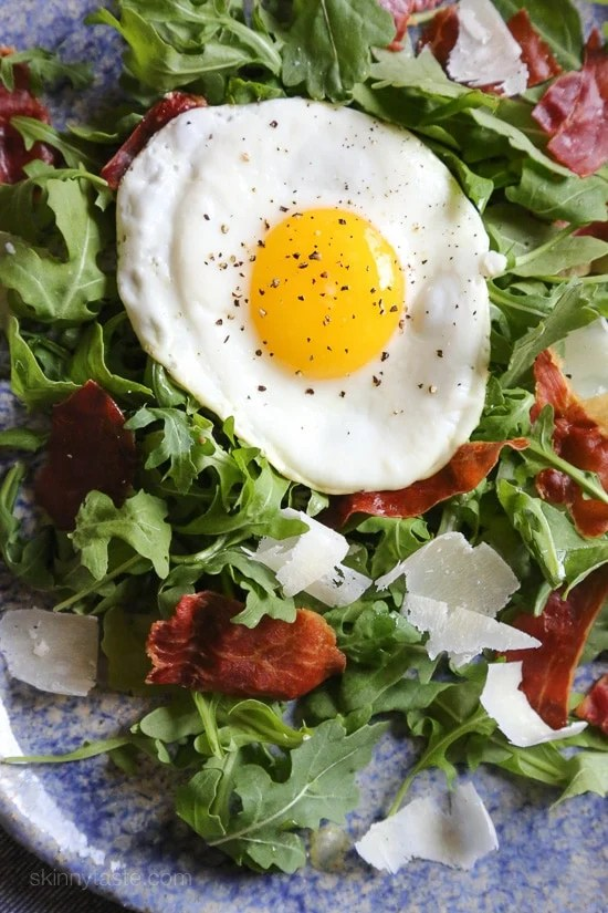 This easy salad has all my favorite things in one – arugula, Proscuitto, shaved Parmesan and a runny egg! When you pop that egg yolk, the salad is bathed in that warm eggy goodness, salad nirvana in every bite! If you are not a fan of runny eggs, hard boiled eggs would taste just fine too!