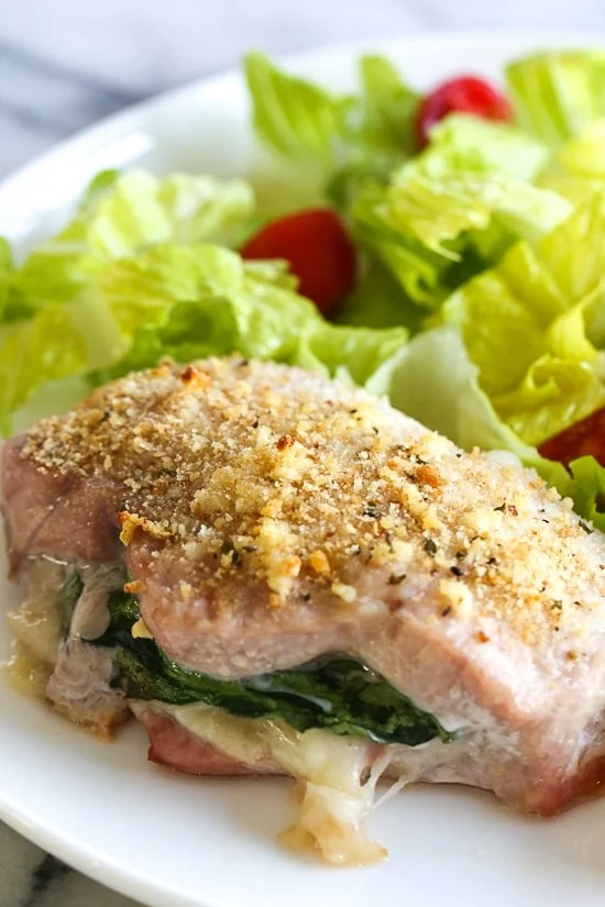 These stuffed pork chops are SO good, inspired my a meal I had at a local Italian restaurant stuffed with prosciutto, mozzarella and baby spinach then topped with garlic and breadcrumbs.