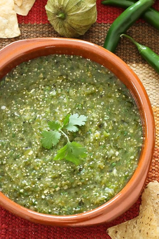 Salsa Verde is a fresh, healthy salsa made with roasted tomatillos, peppers, garlic, onion and cilantro. Perfect for dipping your tortilla chips into or used in recipes that call for jarred Salsa Verde.