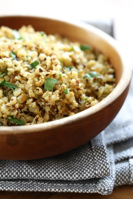 """I love cauliflower """"rice"""", and I love the nutty flavor of roasted cauliflower so I combined the two to make this easy low-carb side dish that goes great with just about anything from chicken, to steak or fish."""