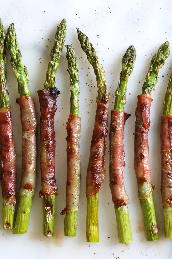 These Prosciutto Wrapped Asparagus, an easy 3-ingredient side dish, can be grilled outside or indoors if you have a grill pan. Perfect as a side dish, or as an appetizer (makes a great addition to your charcuterie platter!)