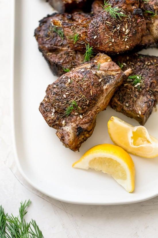 Grilled lamb loin chops seasoned with Za'atar, a Mediterranean blend of sumac, thyme, sesame and salt.