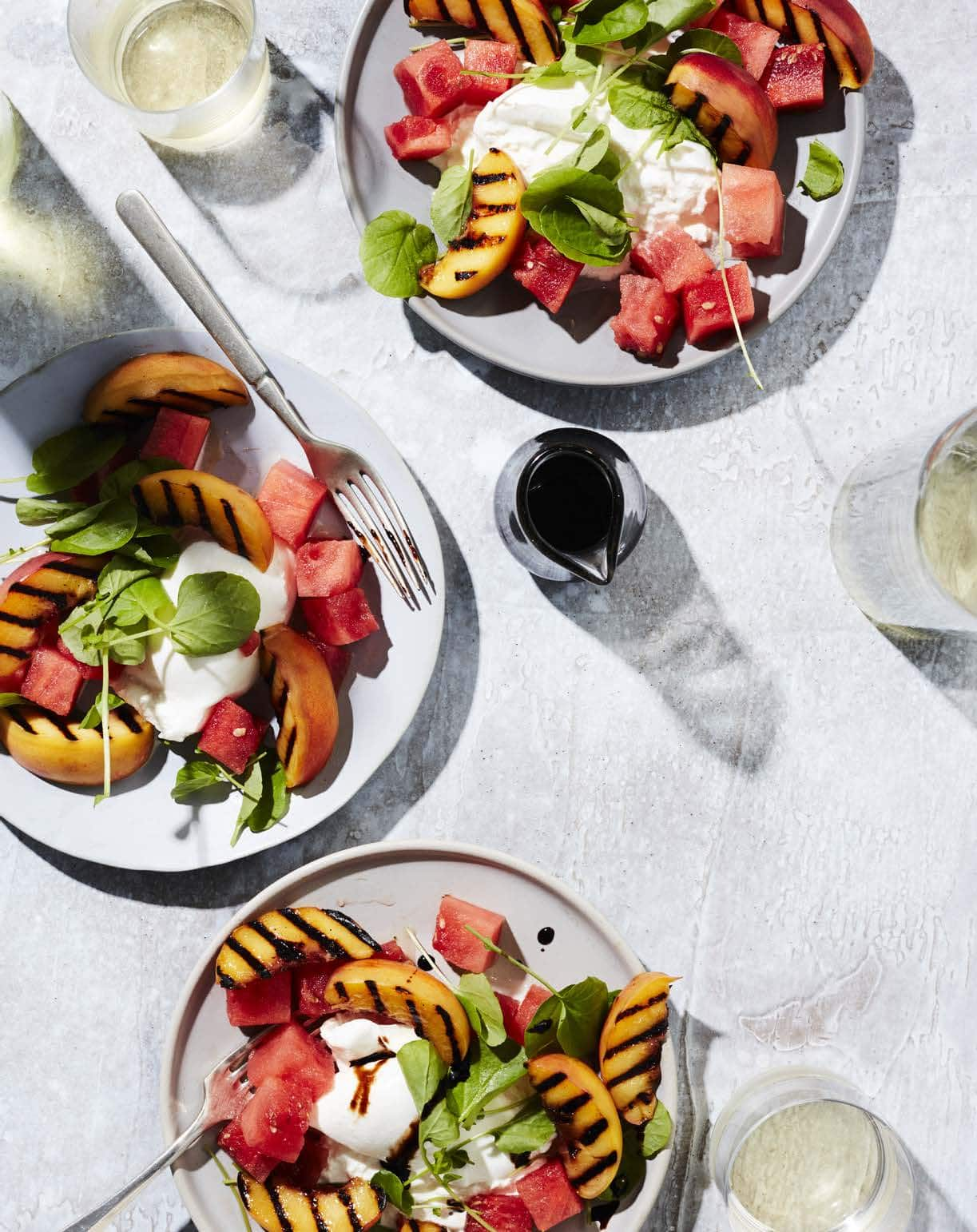 Although burrata—a fresh cheese made with mozzarella and cream—is undeniably the star of this light summer salad, the juicy grilled peaches and refreshing watermelon are pretty hard to resist.