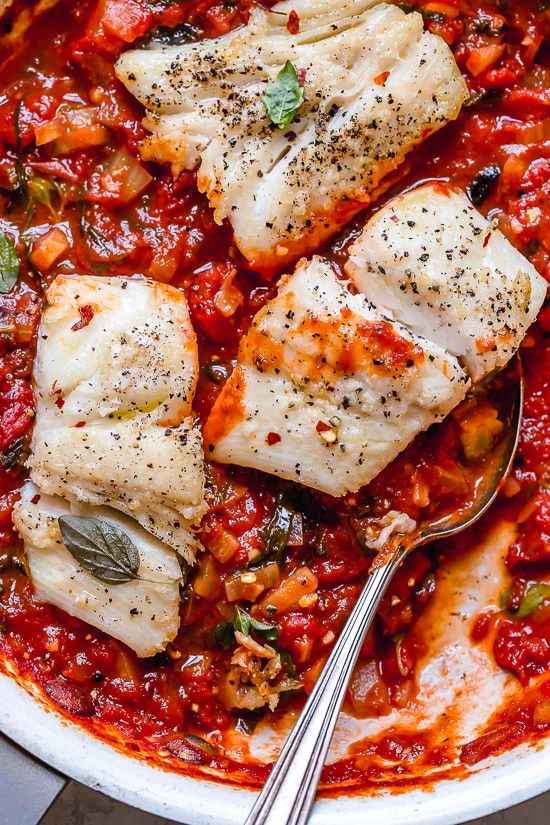 This healthy Mediterranean Sea Bass is smothered in a piquant, healthy, Mediterranean-inspired sauce made from tomatoes, white wine, fennel and olives.