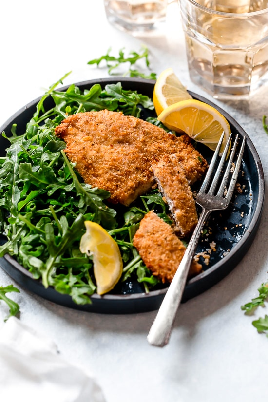 Air Fryer Chicken Milanese with Arugula and lemon wedges is one of my favorite dinners!