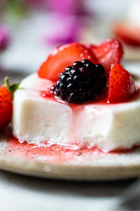 This simple Yogurt Panna Cotta is the perfect smooth, creamy dessert. The cool tang of yogurt pairs perfectly with fresh berries. To macerate the berries simple mix them with a little sugar and let them sit.