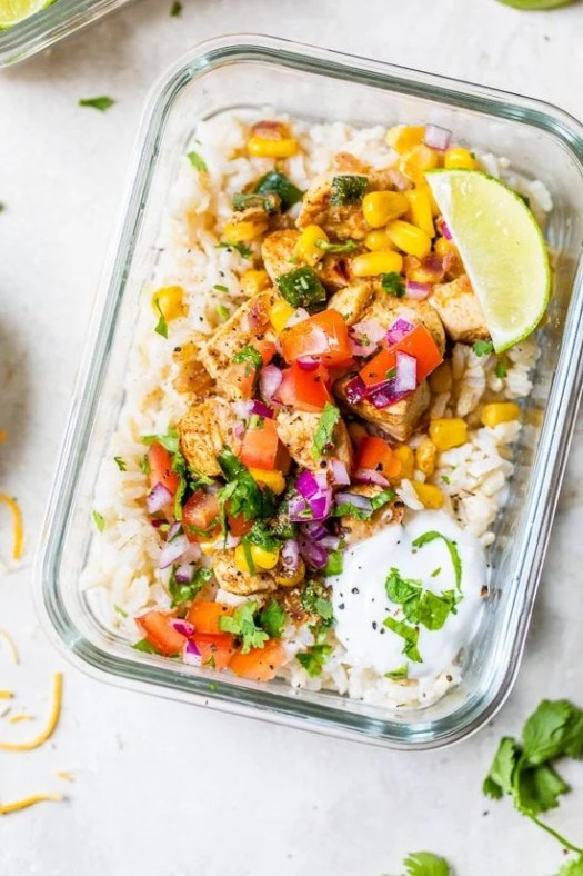 Chicken Taco Poblano Rice Bowls in a glass meal prep container.