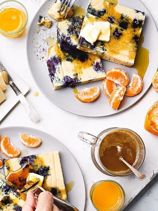 Lemon Blueberry Buttermilk Sheet Pan Pancakes on two plates.