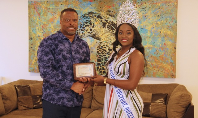 Hon. Mark Brantley, Premier of Nevis receives a token of appreciation from Ms. Shellisa Nanton of St. Vincent and the Grenadines