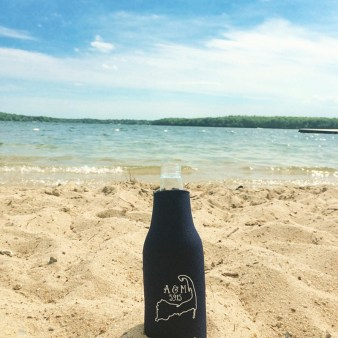 Custom designed bottle coozie with the Cape Cod arm, Couple's initials and wedding date.