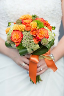 Gorgeous Bridal Bouquet in orange and green done by Katydid Flowers. Photography by Shoreshotz Photography.