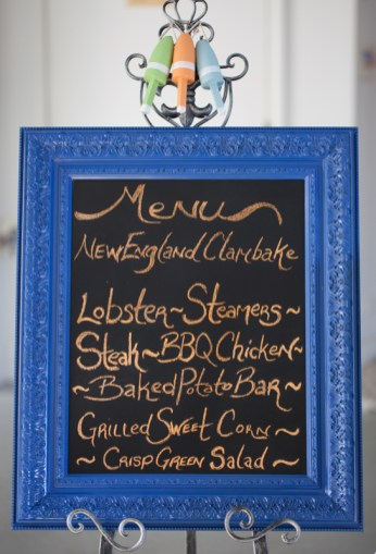 A traditional New England Clambake was served at this Summer backyard tent wedding. The chalkboard menu let guests know what they were having including lobster, corn on the cob, BBQ chicken, steak tips, clam chowder and a baked potato bar. Catering by Dinner & Company. Chalkboard menu by SKO Designs. Photography by Shoreshotz Photography (shoreshotz1.com)