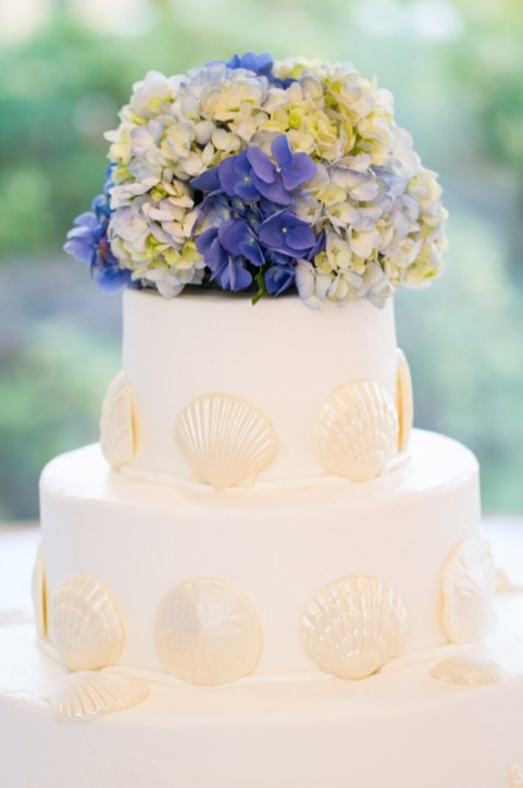 Wedding cake by Montilio's had white chocolate shells around the tiers. Flowers by Katydid Flowers. Photo courtesy of Nicole Lopez Photography.