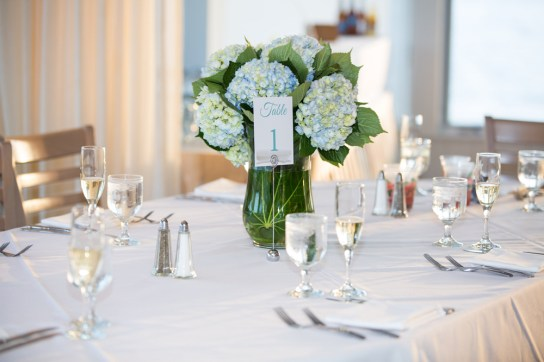 Hydrangea Centerpiece for a beach wedding at Sea Crest Beach Hotel in Falmouth, Cape Cod, Mass. Table number by SKO Designs. Flowers by Katydid Flowers. Photography by Nicole Lopez Photography.