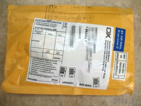 Pacote da DealExtreme com as pilhas LSD GS Yuasa NiMH AA 2000mAh, sem registro e não tributado