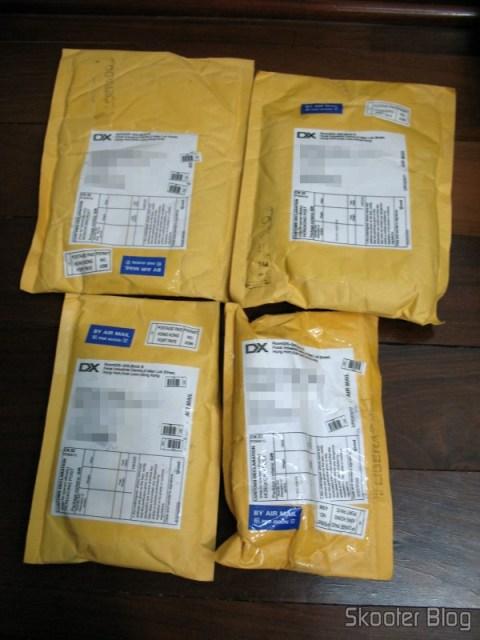 Quatro pacotes da DealExtreme, sem registro e sem imposto