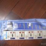 Filtro de Linha com 5 tomadas universais e interruptores individuais em sua embalagem