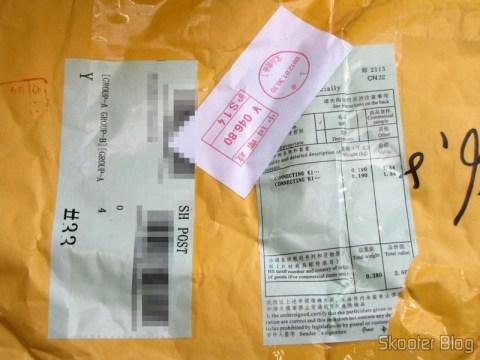 Pacote da DealExtreme (DX) com 10 Discos Blu-Ray BD-R 25GB 4X MAXELL genuínos e a antena que veio por engano