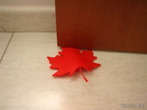 To-Door Style Red Maple Leaf (Maple Leaf Style Door Stopper Guard - Red), in use