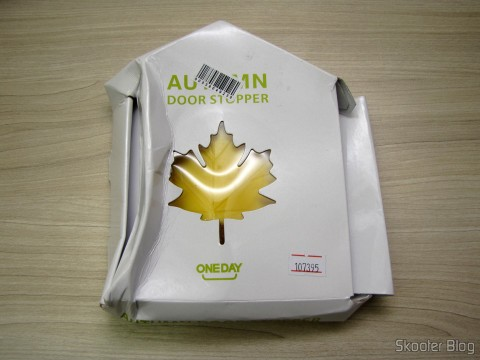 To-Door Style Yellow Maple Leaf (Fashion Maple Leaf Style Door Stopper Guard – Random Color), on its packaging