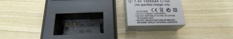 2 Baterias NB-10L para câmera Canon, Carregador USB com LCD, e cabo USB.