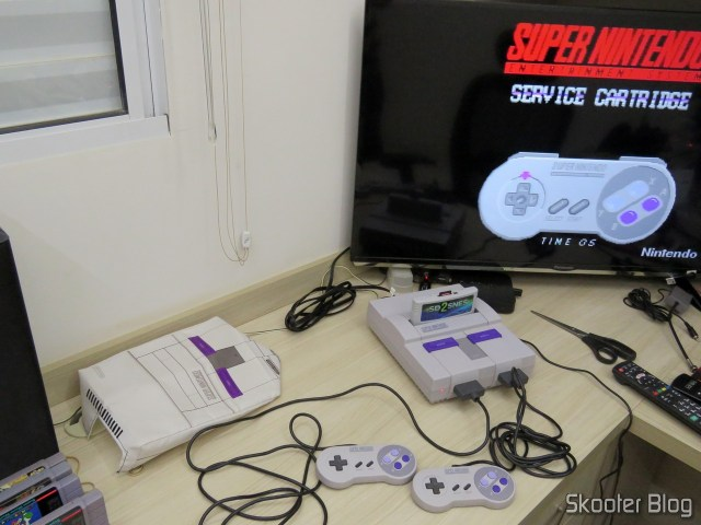Both drivers and the source of the Super Nintendo, being tested.