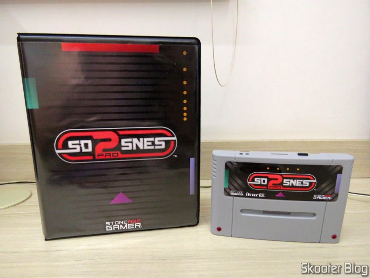 SD2SNES Pro Deluxe and its box.