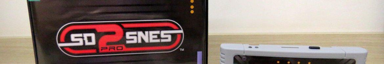 SD2SNES Pro Deluxe e sua caixinha.