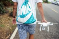 person carrying drone