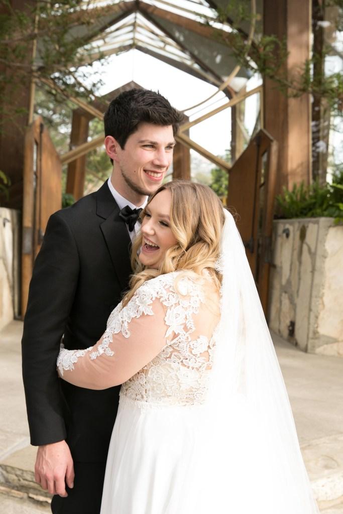bride and groom photograph in front of Wayfarers chapel