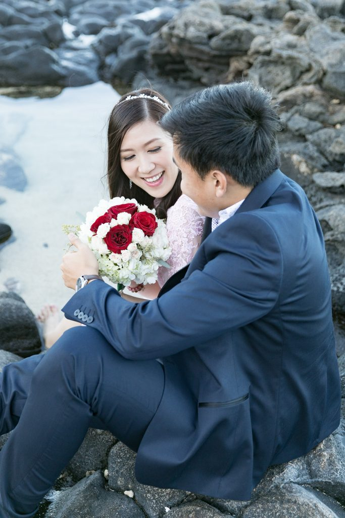 bride shows groom bouquet