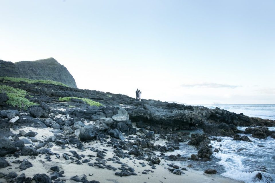 couple standing on rocks makapuu beach