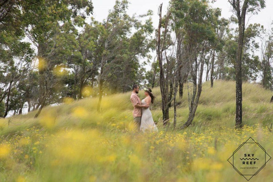 couple in field near Anna's Ranch Waimea