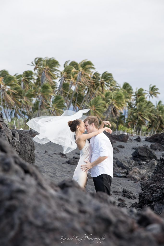 bride and groom kiss on the beach after their elopement