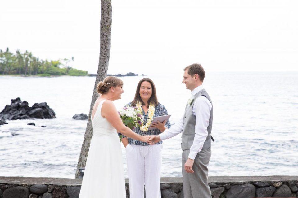 bride and groom in front of ocean Kealakekua Bay Wedding Venue